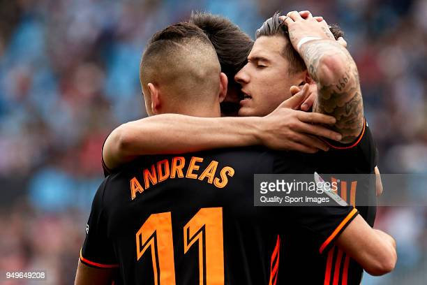 Santi Mina of Valencia CF celebrates with his teammates after scoring his team's first goal during the La Liga match between Celta de Vigo and...