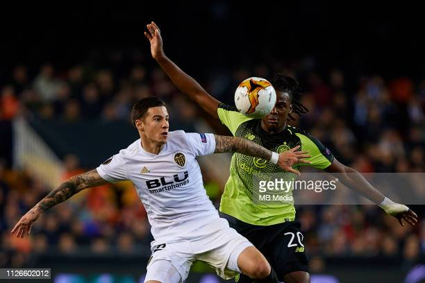 Santi Mina of Valencia CF competes for the ball with Dedryck Boyata of Celtic during the UEFA Europa League Round of 32 Second Leg match between...