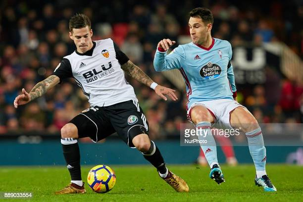 Santi Mina of Valencia CF competes for the ball with Hugo Mallo of Real Club Celta de Vigo during the La Liga game between Valencia CF and Real Club...