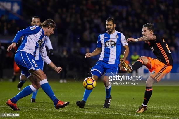 Santi Mina of Valencia CF shots on goal during the La Liga match between Deportivo La Coruna and Valencia CF at Abanca Riazor Stadium on January 13...