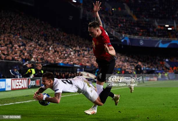 Santi Mina of Valencia competes for the ball with Phil Jones of Manchester United during the UEFA Champions League Group H match between Valencia and...