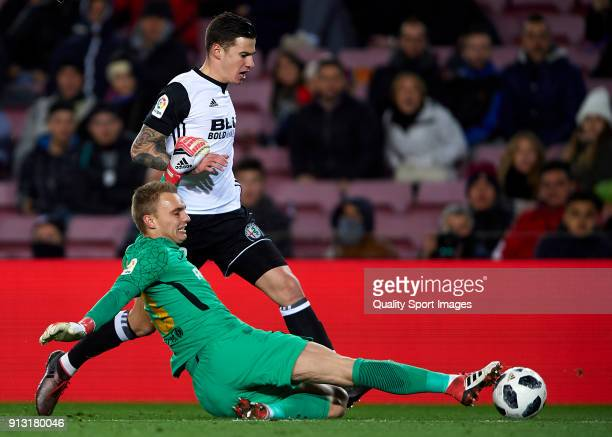 Santi Mina of Valencia is tackled by Jasper Cillessen of Barcelona during the Copa del Rey semifinal first leg match between FC Barcelona and...