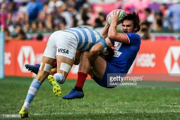 Santiago Alvarez of Argentina makes a tackle on Pierre Mignot of France on the second day at the Hong Kong Sevens rugby tournament on April 6, 2019.