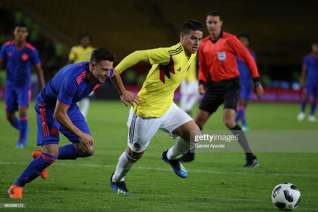 Santiago Arias and James Rodriguez of Colombia fight for the ball during a training session open to the public as part of the preparation for FIFA World Cup Russia 2018 on May 25, 2018 in Bogota, Colombia.