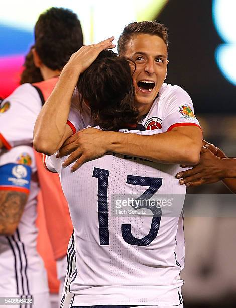 Santiago Arias and Sebastian Perez of Colombia celebrate their shootout win over Peru during a Quarterfinal match at MetLife Stadium as part of Copa...