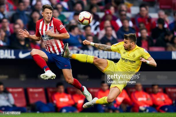 Santiago Arias of Atletico de Madrid battle for the ball with Cristian Portugues of Girona during the La Liga match between Club Atletico de Madrid...