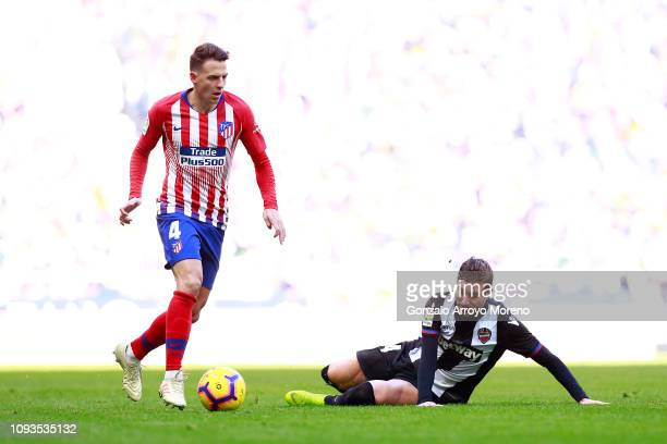 Santiago Arias of Atletico Madrid battles for possession with Jose Campana of Levante during the La Liga match between Club Atletico de Madrid and...