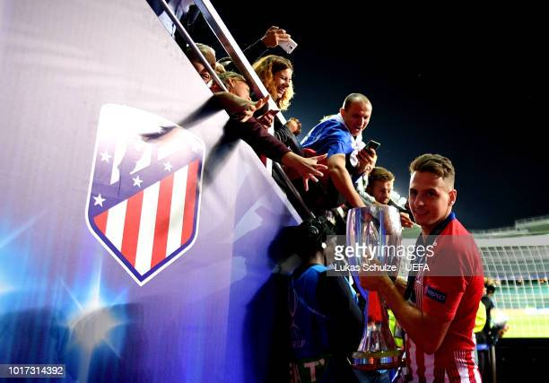 Santiago Arias of Atletico Madrid celebrates victory with the trophy following the UEFA Super Cup between Real Madrid and Atletico Madrid at...