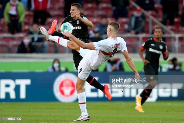 Santiago Arias of Bayer 04 Leverkusen and Sasa Kalajdzic of VfB Stuttgart battle for the ball during the Bundesliga match between VfB Stuttgart and...