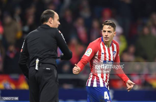Santiago Arias of Club Atletico de Madrid speaks to referee Antonio Mateu Lahoz after his goal was ruled out via VAR during the Copa del Rey Round of...