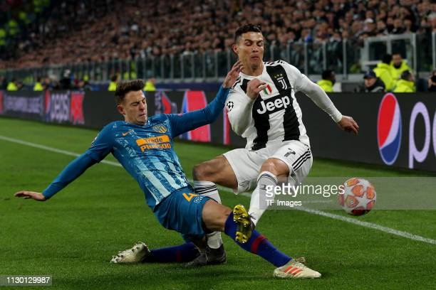 Santiago Arias of Club de Atletico Madrid and Christiano Ronaldo of Juventus battle for the ball during the UEFA Champions League Round of 16 Second...