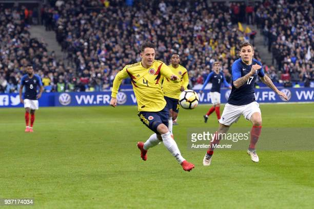 Santiago Arias of Colombia and Lucas Digne of France fight for the ball during the international friendly match between France and Colombia at Stade...