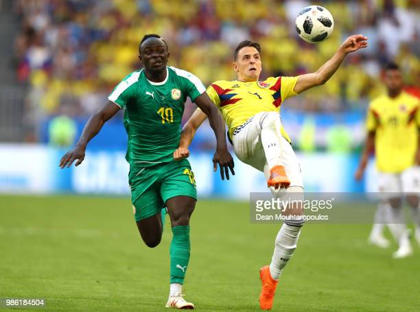 Santiago Arias of Colombia controls the ball under pressure from Sadio Mane of Senegal during the 2018 FIFA World Cup Russia group H match between...