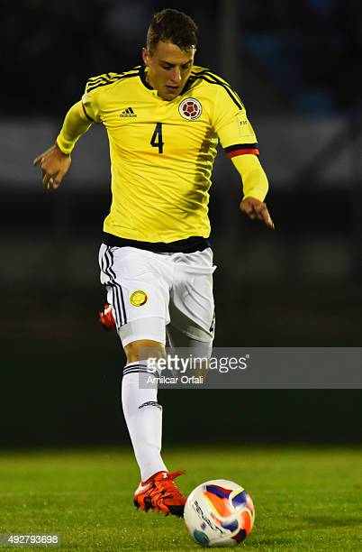 Santiago Arias of Colombia drives the ball during a match between Uruguay and Colombia as part of FIFA 2018 World Cup Qualifier at Centenario Stadium...