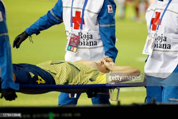 Santiago Arias of Colombia leaves the pitch in a stretcher during a match between Colombia and Venezuela as part of South American Qualifiers for...