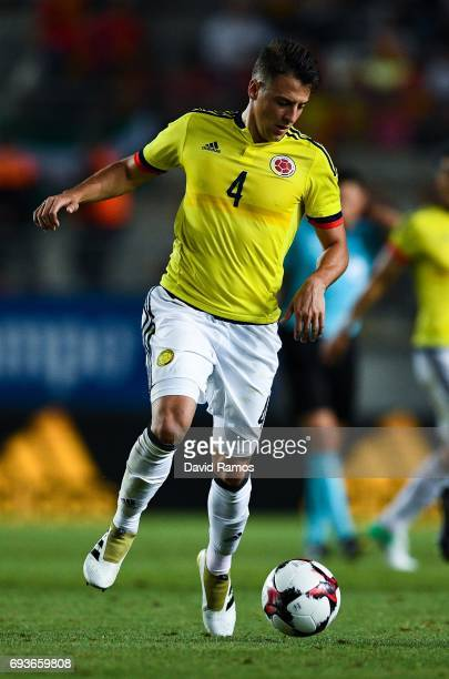 Santiago Arias of Colombia runs with the ball during a friendly match between Spain and Colombia at La Nueva Condomina stadium on June 7 2017 in...
