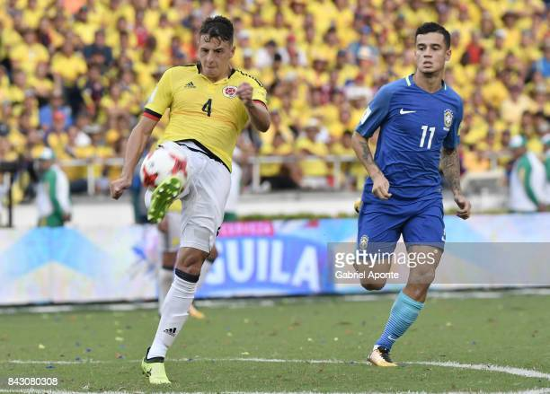 Santiago Arias of Colombia struggles for the ball with Philippe Coutinho of Brazil during a match between Colombia and Brazil as part of FIFA 2018...