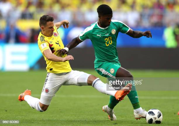 Santiago Arias of Colombia tackles Keita Balde of Senegal during the 2018 FIFA World Cup Russia group H match between Senegal and Colombia at Samara...