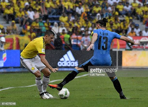 Santiago Arias of Colombia vies for the ball with Gaston Silva of Uruguay during a match between Colombia and Uruguay as part of FIFA 2018 World Cup...