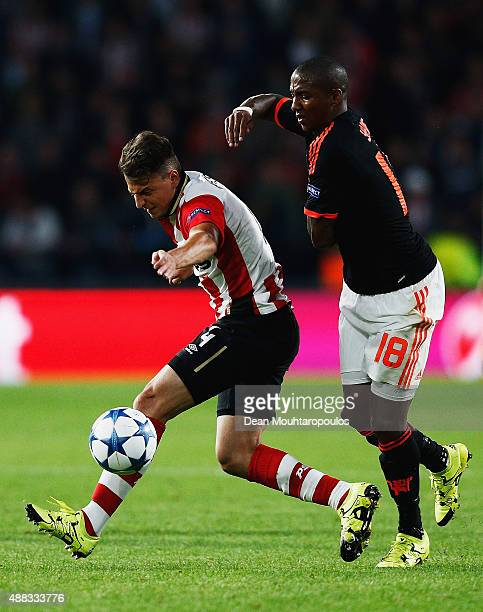 Santiago Arias of PSV Eindhoven is challenged by Ashley Young of Manchester United during the UEFA Champions League Group B match between PSV...