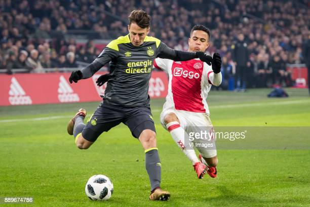 Santiago Arias of PSV Justin Kluivert of Ajax during the Dutch Eredivisie match between Ajax Amsterdam and PSV Eindhoven at the Amsterdam Arena on...
