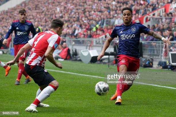 Santiago Arias of PSV Justin Kluivert of Ajax during the Dutch Eredivisie match between PSV v Ajax at the Philips Stadium on April 15 2018 in...