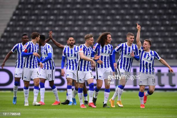 Santiago Ascacibar of Hertha Berlin celebrates with teammates after scoring their team's first goal during the Bundesliga match between Hertha BSC...
