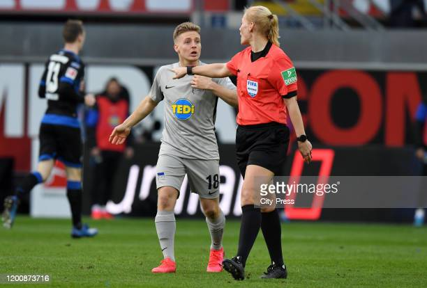 Santiago Ascacibar of Hertha BSC and referee Bibiana Steinhaus during the game between the SC Paderborn 07 against Hertha BSC on february 15 2020 in...