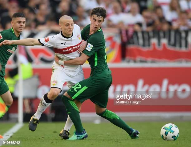 Santiago Ascacibar of Stuttgart is challenged by Marco Friedl of Bremen during the Bundesliga match between VfB Stuttgart and SV Werder Bremen at...
