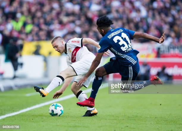Santiago Ascacibar of Stuttgart is challenged by Mohamed Gouaida of Hamburg during the Bundesliga match between VfB Stuttgart and Hamburger SV at...