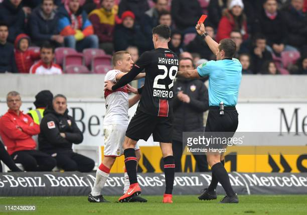 Santiago Ascacibar of VfB Stuttgart clashes with the referee after being sent off during the Bundesliga match between VfB Stuttgart and Bayer 04...