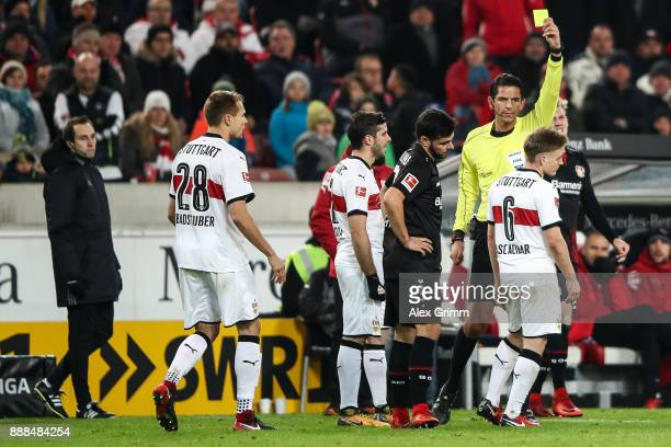 Santiago Ascacibar of VfB Stuttgart is snown a yellow card by referee Deniz Aytekin during the Bundesliga match between VfB Stuttgart and Bayer 04...