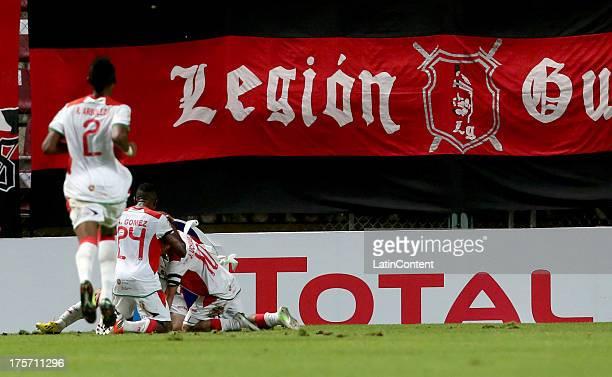 Santiago Barboza of Liga de Loja celebrates a goal with his teammates during a match between Deportivo Lara and Liga de Loja as part of the Copa...