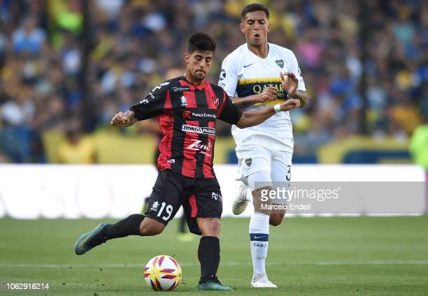 Santiago Brinone of Patronato fights for the ball with Agustin Almendra of Boca Juniors during a match between Boca Juniors and Patronato as part of...