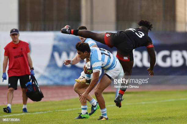 Santiago Carreras of Argentina and Gabriel Ibitoye of England during the World Championship U 20 match between England and Argentina on May 30 2018...