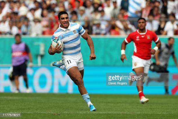 Santiago Carreras of Argentina runs with the ball to score his side's third try during the Rugby World Cup 2019 Group C game between Argentina and...