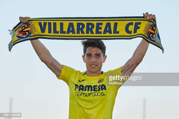 Santiago Caseres of Villarreal CF holds the supporters scarf during his presentation during the PreSeason Friendly match between Villarreal CF and...