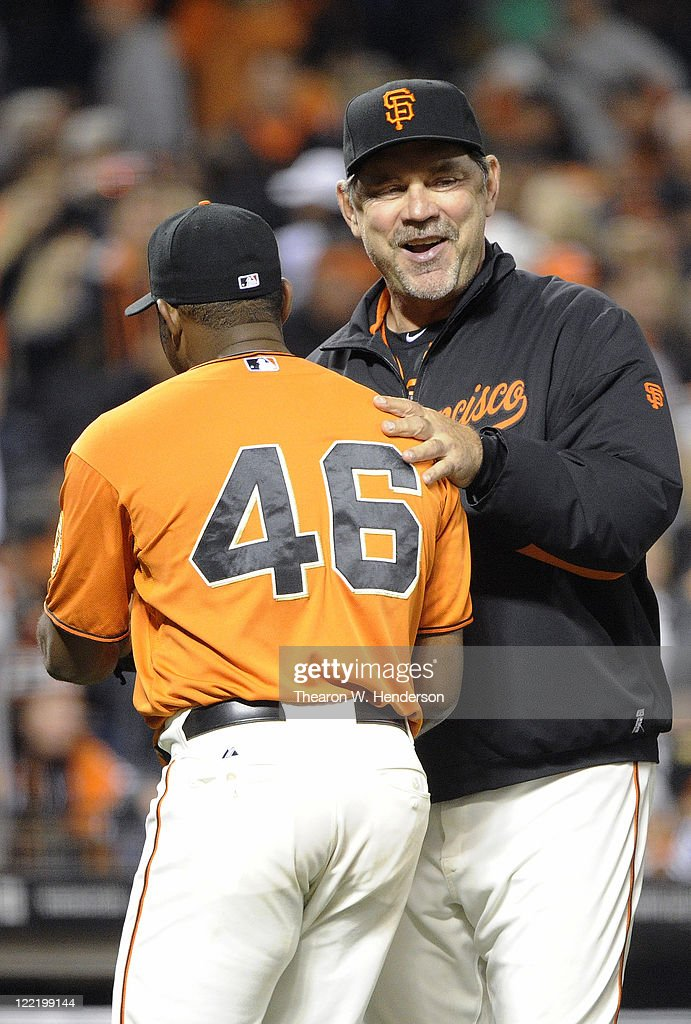 Santiago Casilla #46 and manager Bruce Bochy #16 of the San Francisco Giants celebrate after they defeated the Houston Astros 2 to 1 during an MLB baseball game August 26, 2011 at AT&T Park in San Francisco, California.