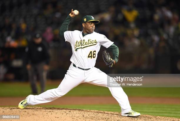 Santiago Casilla of the Oakland Athletics pitches against the Baltimore Orioles in the top of the ninth inning at the Oakland Alameda Coliseum on May...