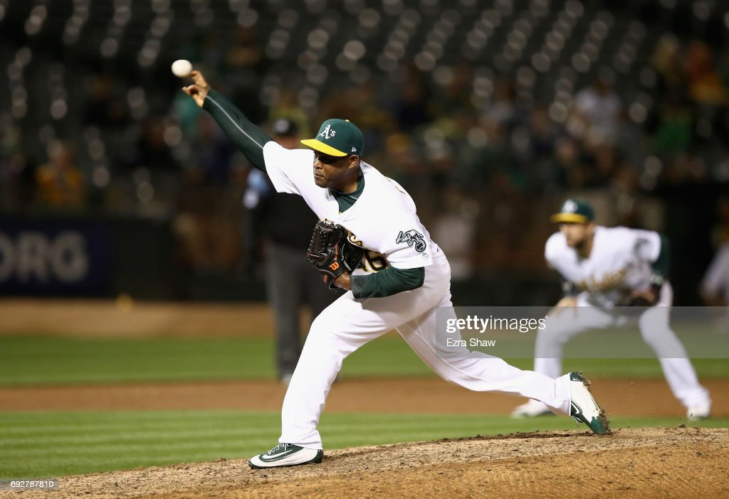 Santiago Casilla #46 of the Oakland Athletics pitches against the Toronto Blue Jays in the ninth inning at Oakland Alameda Coliseum on June 5, 2017 in Oakland, California.