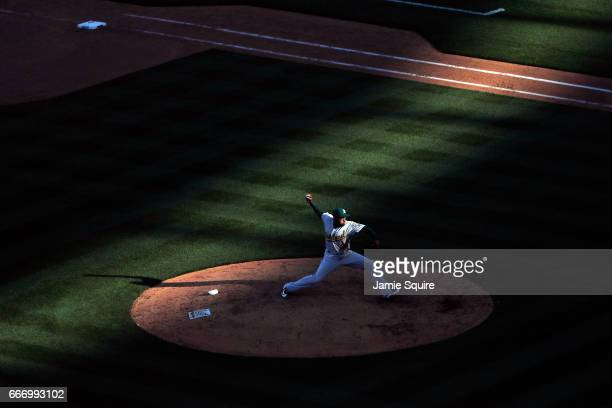 Santiago Casilla of the Oakland Athletics pitches during the Kansas City Royals 2017 home opener at Kauffman Stadium on April 10 2017 in Kansas City...