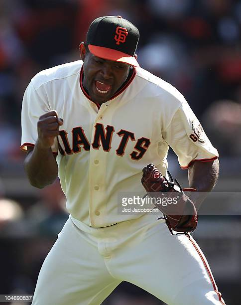 Santiago Casilla of the San Francisco Giants celebrates after getting Scott Hariston of the San Diego Padres to ground out in the sixth inning...