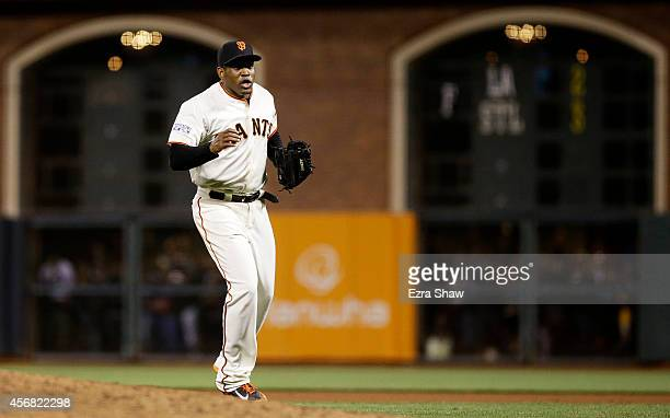 Santiago Casilla of the San Francisco Giants celebrates after the final out of their 3 to 2 win over the Washington Nationals during Game Four of the...