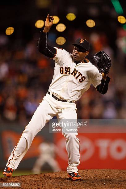 Santiago Casilla of the San Francisco Giants pitches against the New York Mets during the ninth inning at ATT Park on August 18 2016 in San Francisco...