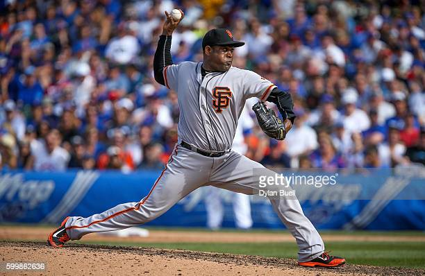 Santiago Casilla of the San Francisco Giants pitches in the ninth inning against the Chicago Cubs at Wrigley Field on September 4 2016 in Chicago...