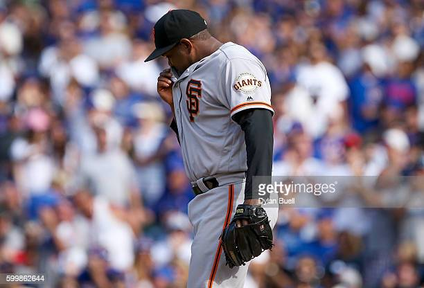 Santiago Casilla of the San Francisco Giants reacts after giving up a walk 9against the Chicago Cubs at Wrigley Field on September 4 2016 in Chicago...