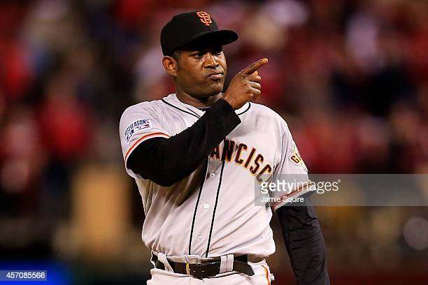 Santiago Casilla of the San Francisco Giants reacts in the ninth inning against the St. Louis Cardinals during Game One of the National League...