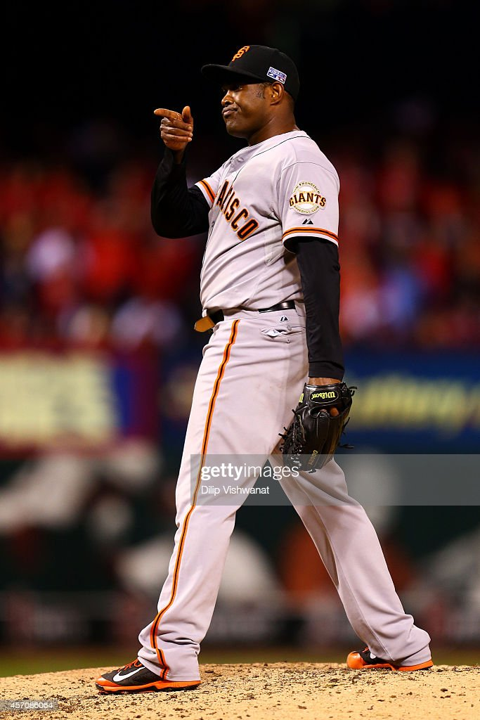 Santiago Casilla #46 of the San Francisco Giants reacts in the ninth inning against the St. Louis Cardinals during Game One of the National League Championship Series at Busch Stadium on October 11, 2014 in St Louis, Missouri.