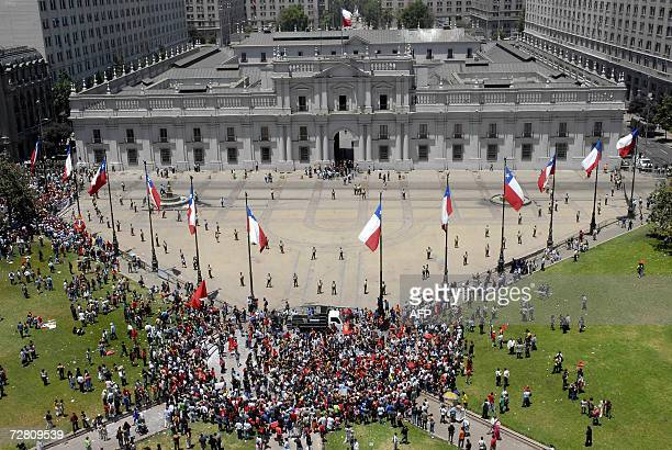 Anti Pinochet activists gather in front of La Moneda presidential palace 12 December 2006 during a demonstration held in parallel to the exequies of...