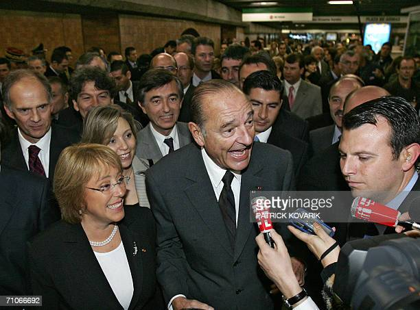 Chilean President Michelle Bachelet and her French counterpart Jacques Chirac speak with the press during a visit to the underground station of...